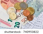 euro banknotes and coins with... | Shutterstock . vector #740953822