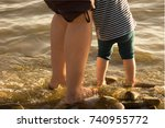 Baby And Female Feet In The...