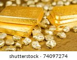 Fine Gold Ingots And Nuggets O...