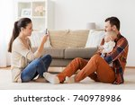 family  parenthood and people... | Shutterstock . vector #740978986