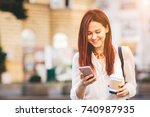 young woman with coffee to go... | Shutterstock . vector #740987935