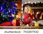 happy little girl wearing... | Shutterstock . vector #741007432