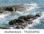 Landscape Of Rough Rocky Cliff...
