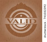 valid badge with wood background | Shutterstock .eps vector #741032392