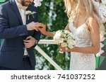Small photo of the bride and groom exchange rings