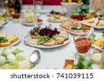 served dishes to the table for... | Shutterstock . vector #741039115