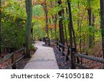 a hiking trail leading into the ... | Shutterstock . vector #741050182