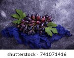 bunch of purple grapes on... | Shutterstock . vector #741071416