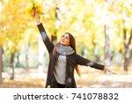 girl in a black coat on a... | Shutterstock . vector #741078832
