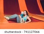 mother and her son jumping on a ...   Shutterstock . vector #741127066