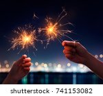 couple holding a burning... | Shutterstock . vector #741153082