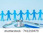 paper patients holding hands on ... | Shutterstock . vector #741210475