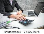 business women using calculator ... | Shutterstock . vector #741276076
