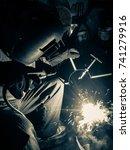 welders working at the factory... | Shutterstock . vector #741279916