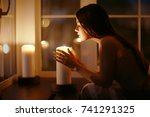 girl candles divination... | Shutterstock . vector #741291325
