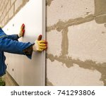 the worker insulates the house...   Shutterstock . vector #741293806