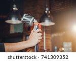 Singer Hands Holding Microphon...
