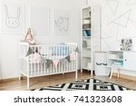large bookshelf decorated with... | Shutterstock . vector #741323608