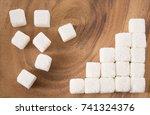 ascending stacks of sugar cubes ... | Shutterstock . vector #741324376
