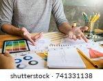 two young women working as... | Shutterstock . vector #741331138