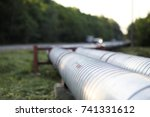 metal pipes on the street.... | Shutterstock . vector #741331612