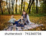 happy mom with son and daughter ... | Shutterstock . vector #741360736