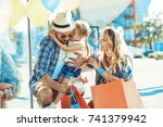 happy family walking with... | Shutterstock . vector #741379942