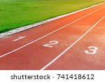 Small photo of All-weather running track, for athletes or people who want to practice and exercise, next to the green glass field