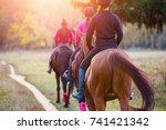 group of teenage girls riding...
