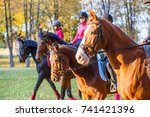 Stock photo group of teenage girls riding horses in autumn park equestrian sport background with copy space 741421396