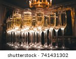 a lot of glasses of champagne... | Shutterstock . vector #741431302