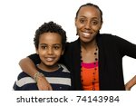 Portrait picture of a young boy with his big sister - stock photo