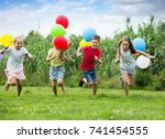 four small kids happily playing ...   Shutterstock . vector #741454555