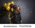 joyful woman with bunch of... | Shutterstock . vector #741455056