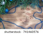 Small photo of Christmas and New Year wooden background with fir tree acerose, blue and silver balls and garland ornament decoration, copy space