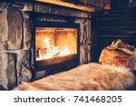 warm cozy fireplace with real... | Shutterstock . vector #741468205