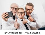 father  son and grandfather...   Shutterstock . vector #741530356