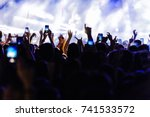 audience recording video of... | Shutterstock . vector #741533572