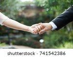 hold hands of wedding couple  | Shutterstock . vector #741542386