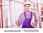 adult male surveyor in coverall ... | Shutterstock . vector #741553396