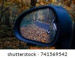 autumn in the rearview mirror | Shutterstock . vector #741569542