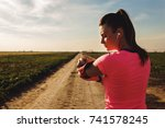 athletic woman preparing run on ... | Shutterstock . vector #741578245