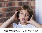 beautiful little girl with...   Shutterstock . vector #741591442