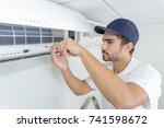 portrait of mid adult male... | Shutterstock . vector #741598672