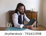 handsome dark haired and... | Shutterstock . vector #741611908