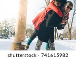 happy couple on winter vacation.... | Shutterstock . vector #741615982