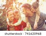 parents walking with daughters... | Shutterstock . vector #741620968