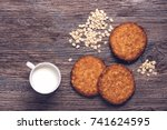 oatmeal cookies with milk on a... | Shutterstock . vector #741624595