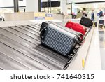 suitcase on luggage conveyor... | Shutterstock . vector #741640315