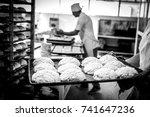 hands of the teacher baker in...   Shutterstock . vector #741647236